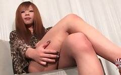 Transsexual asian sweetie slowly takes off her panties.