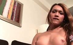 Adorable asian tranny is posing and caressing herself.