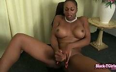 Lovely chocolate tranny gives helping hand to her penis.